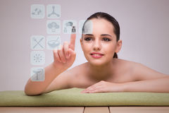 The woman in spa pressing buttons Royalty Free Stock Photos