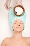 Woman at spa procedures applying mask Stock Image