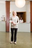 Woman in Spa Reception Royalty Free Stock Photography