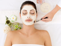 Woman at spa salon with cosmetic mask on face Royalty Free Stock Images