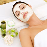 Woman at spa salon with cosmetic mask on face . Royalty Free Stock Photos