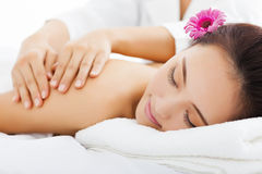 Woman in spa salon getting massage Stock Photo