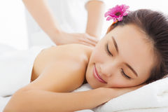 Woman in spa salon getting massage Stock Images