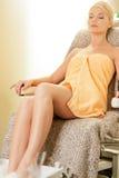 Woman in spa salon having pedicure royalty free stock photos