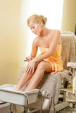 Woman in spa salon having pedicure Royalty Free Stock Photography