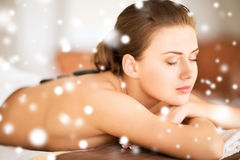 Woman in spa salon with hot stones Royalty Free Stock Images