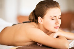 Woman in spa salon with hot stones Stock Image