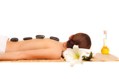 Woman in spa salon with hot stones Royalty Free Stock Photos