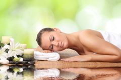 Woman in spa salon. Lying on the massage desk royalty free stock photos