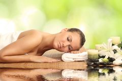 Woman in spa salon. Lying on the massage desk stock images