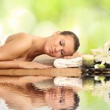 Woman in spa salon. Lying on the massage desk royalty free stock image