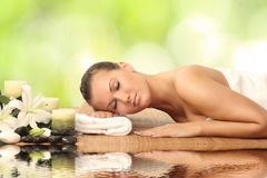 Woman in spa salon. Lying on the massage desk royalty free stock photography