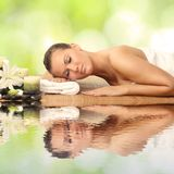 Woman in spa salon. Lying on the massage desk stock photos