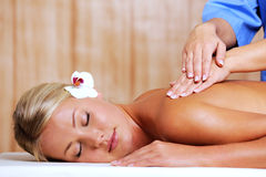 Woman in spa salon on massage Royalty Free Stock Photography