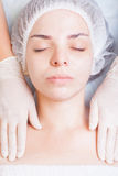 Woman in spa salon receiving skin treatment with body cream Royalty Free Stock Photography