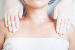 Woman in spa salon receiving skin treatment with body cream Royalty Free Stock Image