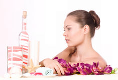 Woman with spa salts and orchid Stock Photo