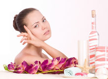Woman with spa salts and orchid Stock Image