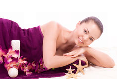 woman with spa salts and orchid Stock Photos