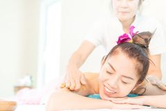Woman in Spa with smile while taking back massage by Spa Therapist Stock Photos