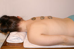 Woman in Spa With Stones on Back Royalty Free Stock Photography