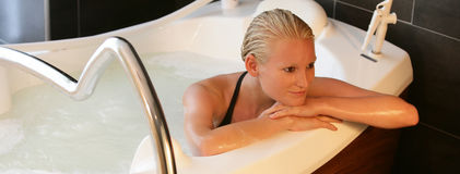Woman in spa theraphy bath Stock Photo