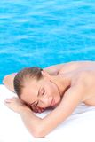 Woman during spa treatment next to pool. Woman during spa treatment next to swimming pool royalty free stock photos