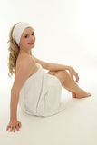 Woman at spa. Woman wearing white towel on her head relaxing at spa Stock Image