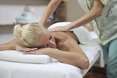 Woman at spa and wellness back massage royalty free stock photo