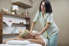 Woman at spa and wellness back massage stock photos