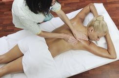 Woman at spa and wellness back massage Royalty Free Stock Image