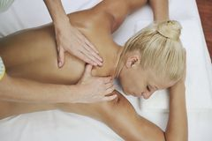 Woman at spa and wellness back massage stock images