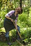 Woman with spade in a garden Royalty Free Stock Photos