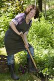 Woman with spade in a garden Royalty Free Stock Images