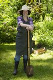 Woman with spade in a garden Stock Photography
