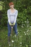 Woman With Spade Standing In Garden Stock Photos