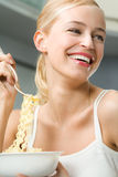 Woman with spaghetti Royalty Free Stock Image