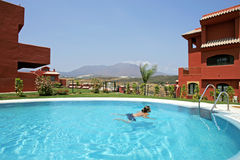 Woman in Spain, swimming in pool. Woman in swimming in pool in Spain on a sunny day royalty free stock photo