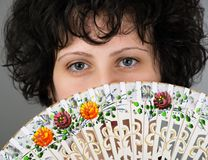 Woman with a Spanish fan trditional Stock Photography
