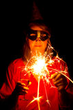Woman with sparkler Stock Images