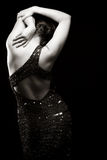 Woman in sparkly dress. Facing away. Black and white stock images