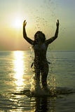 Woman in the sparks of water. On the Baltic sea Royalty Free Stock Images