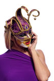 Woman speak on the phone. Pretty young woman in violet mask speak on the iPhone, isolated on white Stock Photo