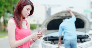 Woman speak phone due to accident stock photography