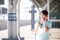 Woman speak on phone happily royalty free stock images
