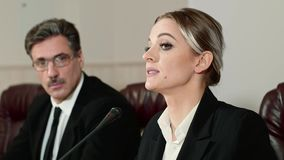 Businesswoman speaker answers the journalists questions on press conference. stock footage
