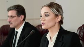 Businesswoman speaker answers the journalists questions on press conference. stock video