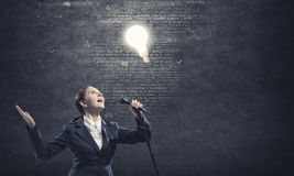 Woman speaker. Concept image Royalty Free Stock Images