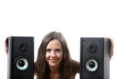 Woman with a speakers. Beatuifull woman hold a speakers royalty free stock photos