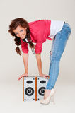 Woman with speakers Royalty Free Stock Photography